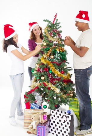 happy young family decorating christmas tree Stock Photo - 8112054