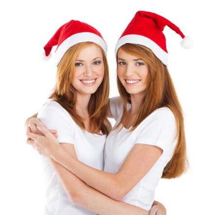 twin sister: pretty sisters wearing christmas hats