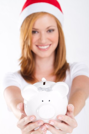 pretty xmas girl holding piggybank forward photo