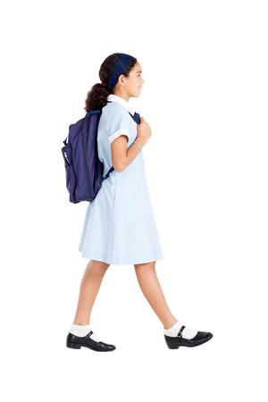 school uniform girl: young school student walking to school on white