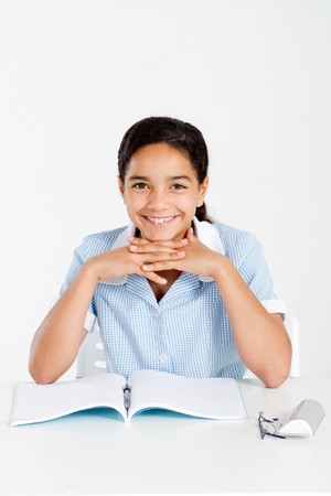 happy elementary school student in classroom Stock Photo - 8196935