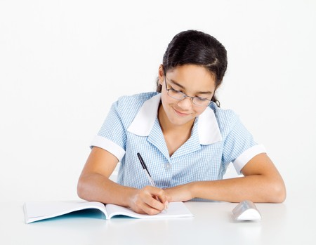 writing on glass: smart junior high student studying at desk Stock Photo
