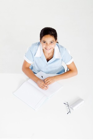 overhead of happy school girl studying at desk Stock Photo - 8196848