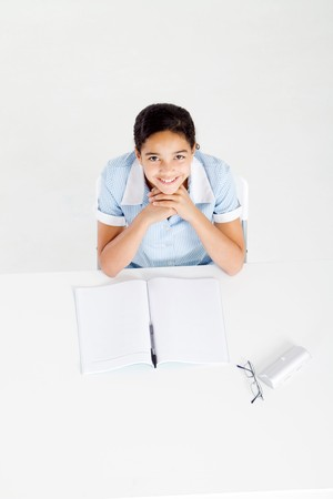 overhead of high school girl at her desk Stock Photo - 8196925