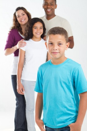 young boy with happy family in background photo