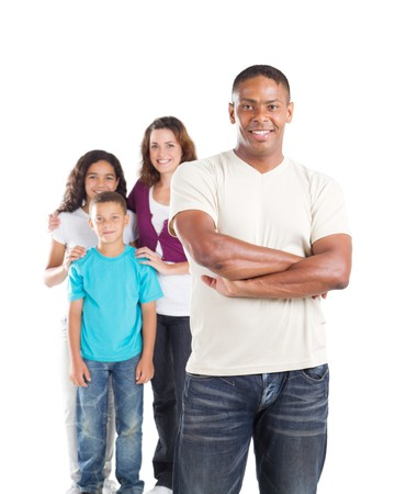 mixed family: young father with family in background Stock Photo