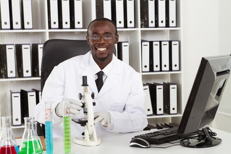 african scientiest working in research lab photo