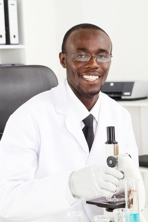 happy african scientist in lab Stock Photo - 8306638