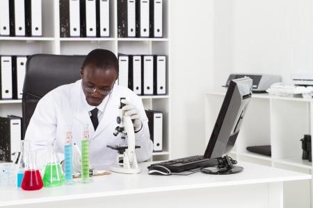 african scientist working lab at desk photo