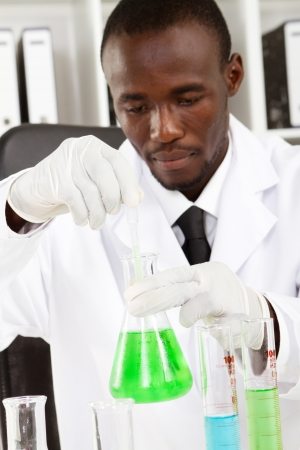 white glove test: african american man doing lab work in hospital