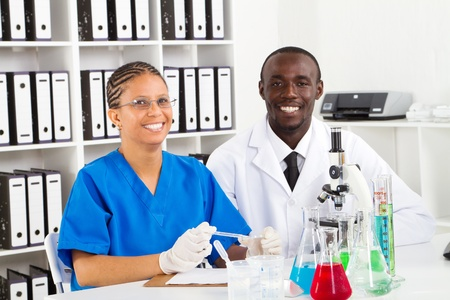 happy young scientists in laboratory photo
