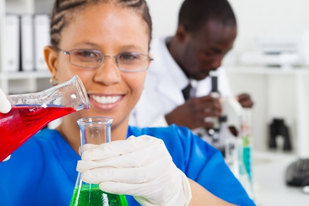 laboratory technician: happy african american scientists working in lab Stock Photo