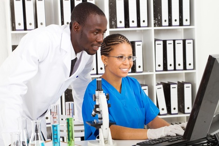 two young african scientists working in lab photo