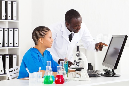 two african scientists working in lab photo