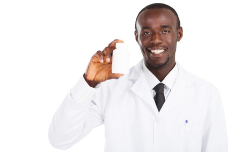 friendly african american pharmacist holding medicine photo