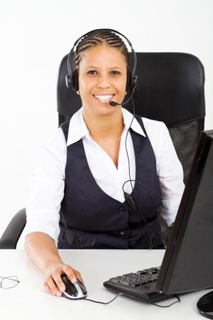 telephone saleswoman: happy african telephone saleswoman Stock Photo