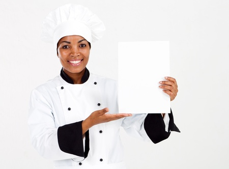 african american female chef presenting menu photo