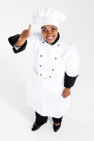 african american female chef giving thumb up photo