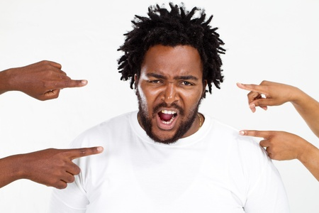 fingers pointing at angry overweight african american man Stock Photo - 8776876