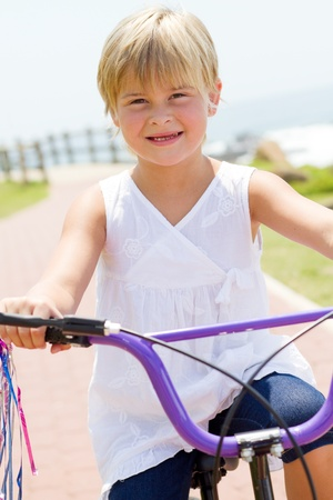 young mom watching daughter ride bicycle Stock Photo - 8993452