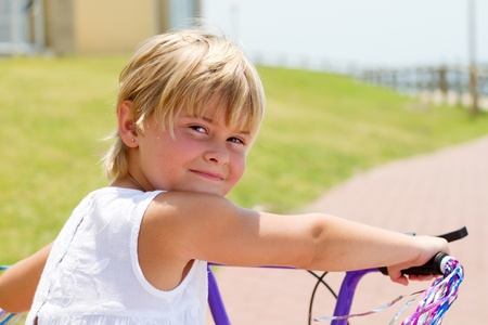 cute girl riding bicycle outdoors Stock Photo - 8993444