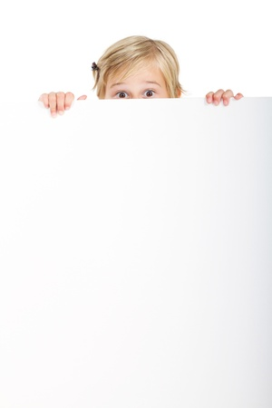 little girl behind blank whiteboard Stock Photo - 9070320