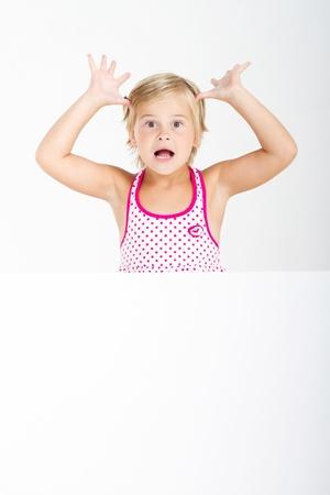 cute little girl behind whiteboard Stock Photo - 9070322
