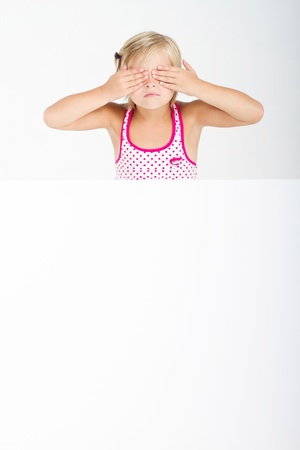 cute girl covering eyes with whiteboard Stock Photo - 8989614