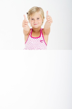 thumbs up girl holding signboard Stock Photo - 8993430
