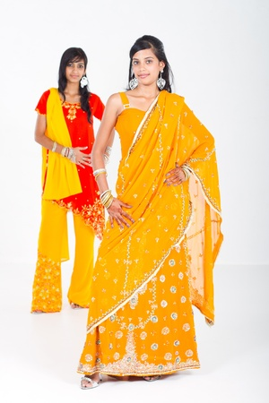 costume jewelry: indian young women in saris Stock Photo