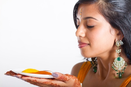 curry spices: indian woman smelling spices Stock Photo