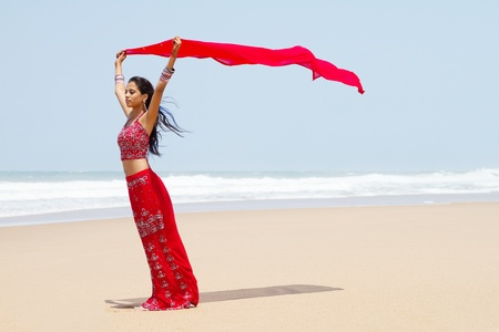 indian ocean: indian woman with scarf in wind