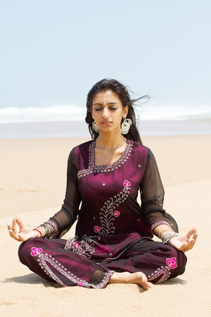 indian traditional: india yoga woman on beach Stock Photo