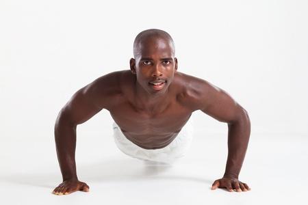 african man doing push ups photo
