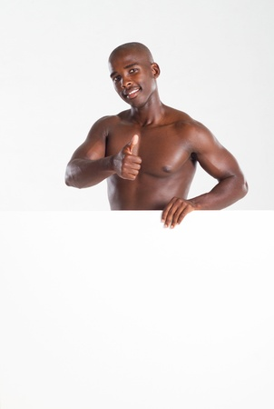 thumbs up man holding whiteboard photo