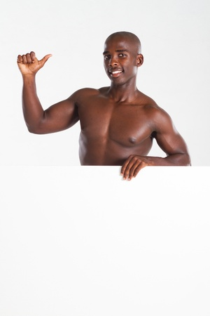 confident fit man holding whiteboard photo