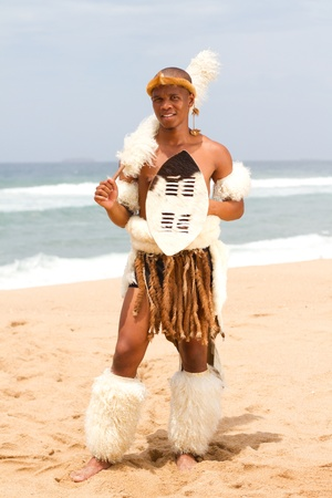 warrior tribal: traditonal zulu man on beach Stock Photo