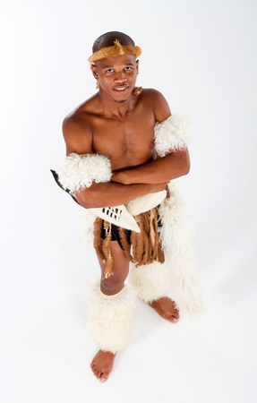 overhead of zulu man in costume on white photo