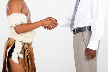 tribesman and modern african businessman handshake photo