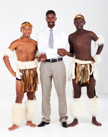 modern businessman with tribesman photo