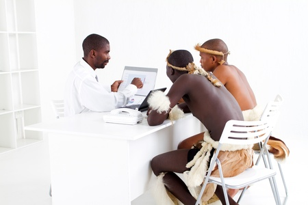 traditions: modern and traditional african business meeting