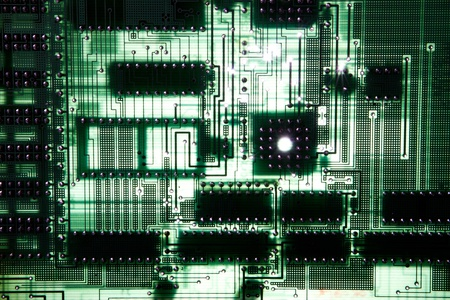 Close up of computer circuit board in green photo