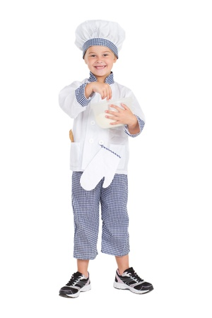 little girl in bakers uniform mixing flour, isolated on white photo