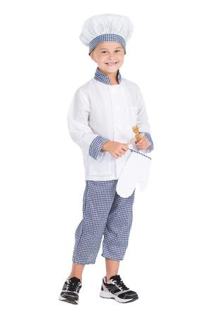 ni�os cocinando: ni�a feliz en el retrato de estudio uniforme de cocinero