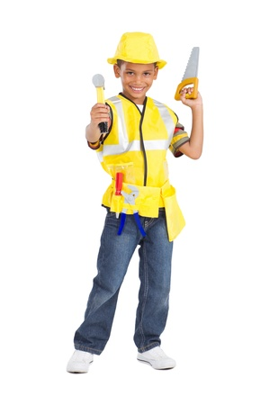 cute little boy in construction uniform and holding tools photo