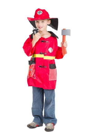 fire fighter: little boy as fireman blowing his whistle and hold a axe