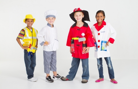 group of children dressing in various uniforms photo