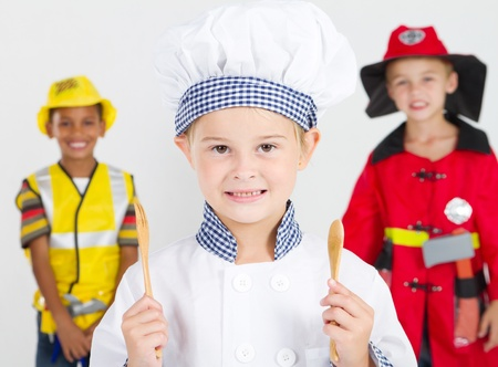 role: happy little chef in front of construction worker and fireman Stock Photo
