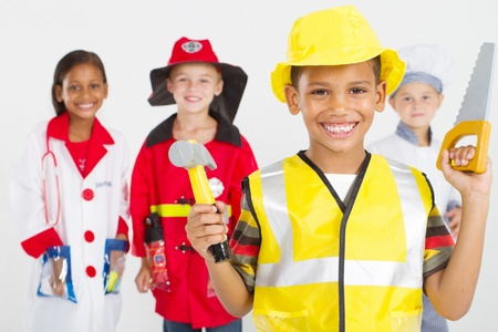 group of happy little workers in various uniforms Stock Photo - 9169035