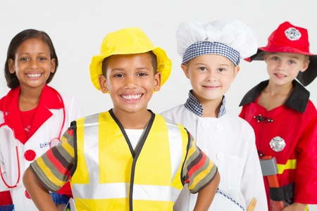 group of happy little workers in various uniforms photo